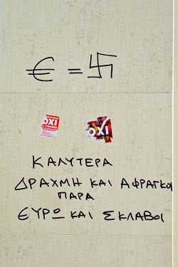 Graffiti on the exterior wall of a bank in central Athens on the day before a national referendum to acceptance or reject economic reforms demanded by the country's creditors. The outcome could determ...