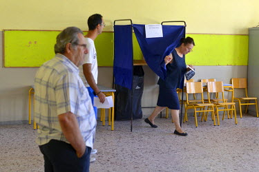 Voting taking place inside a classroom at a secondary school in the Nikai neighbourhood.  On 5 July 2015 Greeks voted in a referendum to acceptance or reject economic reforms demanded by the country's...