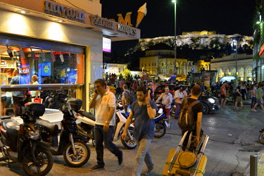 People in the popular tourist district of Monastiraki on the day before a national referendum to acceptance or reject economic reforms demanded by the country's creditors. The outcome could determine...
