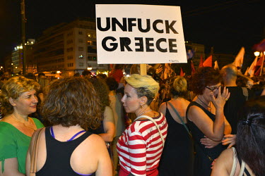 Supporters of the 'Oxi' (No) vote in the referendum celebrate their surprise 61 percent to 39 percent victory in Syntagma Square infront of the Greek Parliament building.  On 5 July 2015 Greeks voted...