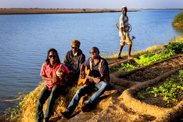 The Mali Allstars band sitting on the banks of the Niger River during the Festival sur le Niger.