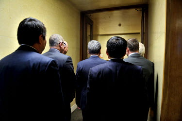 Diplomat representatives of various nations (including France, America, Khazakstan, Mongolia, Germany and UK) waiting to greet a visiting Mongolian government official, due to address the Conference o...