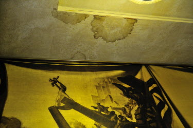 A stain spreads over the ceiling of the Council Chamber at the Conference on Disarmament. The chamber is older than the UN having been originally constructed to seat the League of Nations.  The Confe...