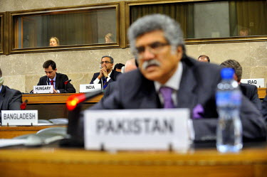 DB Venkatesh Varma, Permament Representative of India to the Conference on Disarmament, listening to Ambassador Munir Akram addressing the conference, who stated that the security of some could not co...