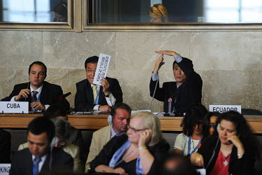 North Korean diplomats, supported and encouraged by the Cuban delegate, attempting to make a statement to the Conference on Disarmament.The Conference on Disarmament, established in 1979, is the only...