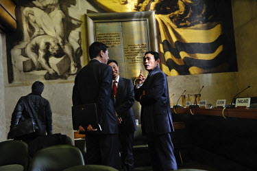 Jon Yong Ryong, First Secretary of North Korea's mission in Geneva, in discussion with Chinese diplomats at the end of a meeting of the Conference on Disarmament in which North Korea's third nuclear t...