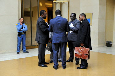 African delegates to the Conference on Disarmament in discussion outside the Council Chamber following the closing of the session. Access to the floor of the chamber is controlled by UN security staff...
