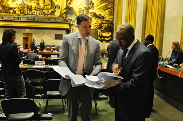 A Swiss diplomat discussing documents with Ivor Fung, Senior Political Affairs Officer and Secretary of the Conference on Disarmament.  The Conference on Disarmament, established in 1979, is the only...