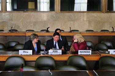 A discussion at the Conference on Disarmament between (L-R) Joanne Adamson, Wu Haitao, and Laura Kennedy, the British, Chinese and United States Ambasadors, following the end of the session. They repr...