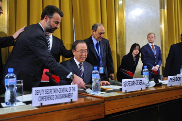 An assistant places the text of his speech before UN Secretray General Ban Ki-moon as he takes his seat prior to addressing the Conference on Disarmament on its opening session of the year. The Confer...