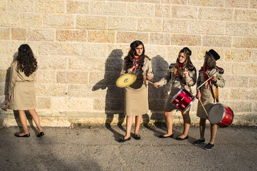 Members of the Palestinian Girl Scouts of Ramallah gather for band practice. Faiza (with cymbals) and her family left Gaza following the Gaza War of 2014. The Girls Scouts in this region were founded...