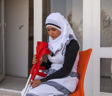 14 year old Nour from Allepo, who lost her right leg in a bomb attack, outside the prostethics clinc where she was originally treated and where she has come for further physiotherapy. The clinic was s...
