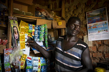 Nasa Oyoo Otii, 47 years old, in his small shop. In 2000, he fled Lord's Resistance Army insurgency with his wife and children to become IDPs in Masindi (approx. 235kms away). He returned to Pader in...