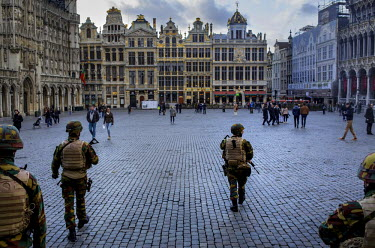 Armed soldiers patrol the Central Square (Grande Place) in Brussels following the Brussels terrorist attacks.  On 22 March 2016 two terrorist suicide attacks - at Brussels' Zaventem airport and at the...