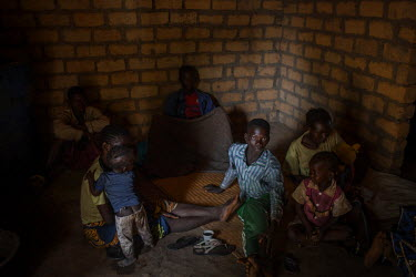 People sit on the floor of a building at an IDP camp in Kaga Bandoro, where 16,000 Christians (August 2015 estimate) are living in poor sanitary conditions after they fled their  homes in fear of viol...