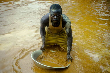 A man pans for gold in Ndassima gold mine, the largest in CAR, where several hundred miners produce an estimated 15kg of gold per month. The mine his controlled by ex-Seleka General Ali Daras who coll...