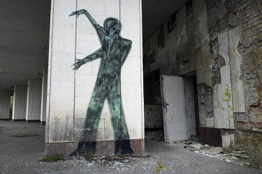 Graffiti of a human silhouette on a building in Pripyat which was evacuated within 48 hours of the nuclear power plant disaster on 26 April 1986. In recent years controlled tours have been allowed int...