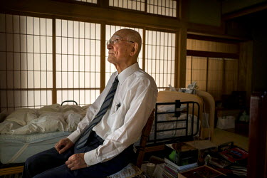 Yoshitoshi Fukahori, an atomic bomb survivor and the chairperson of the Research Committee for Photographic Records of Nagasaki Atomic Bombing at the Nagasaki Foundation for the Promotion of Peace, in...