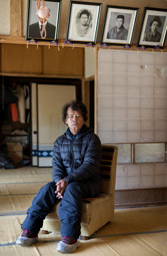 Toru Anzai sits in his abandoned house in the village of Itate. He was a rice farmer but his fields have been contaminated following the 2011 Fukushima Daiichi nuclear disaster and he has not been abl...