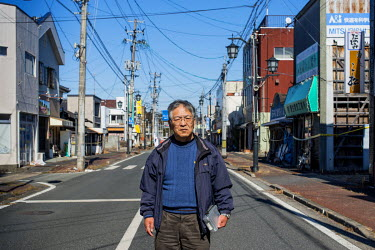 Kamakura Toyotaka, 65, standing on a street in the city of Namie where he had ran what was considered the town's best florist's shop. Following the 2011 Fukushima Daiichi nuclear disaster the town's 1...