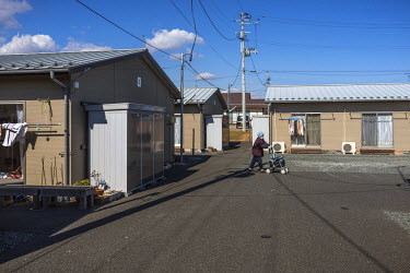 Koike 1 camp on the outskirts of the city of Minamisoma, 30 kilometres from the Fukushima nuclear power plant. Some two hundred people live here in small prefabricated houses, each no more than 15 squ...