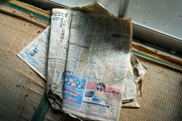 Old newspapers in the house of a rice farmer in Itate village abandoned following the 2011 Fukushima Daiichi nuclear disaster.  On 11 March 2011 a magnitude 9 earthquake struck 130 km off the coast of...