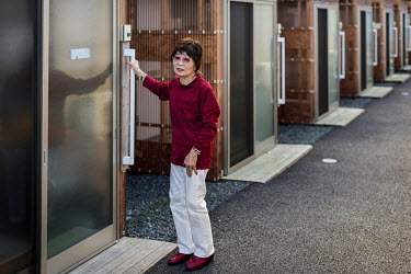 Inaride Yuko sits outside the home in the Koike 1 camp where she has been living since 2011. Her home, one kilometre from the sea, was destroyed during the tsunami that followed the 11 March 2011 magn...