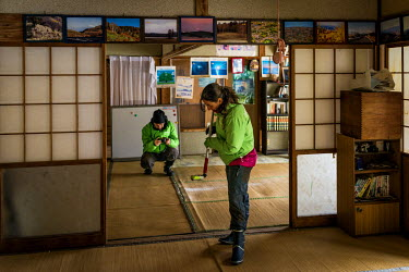 Raquel Monton, head of Greenpeace's anti-nuclear energy campaign, measuring radiactivity in the house of Turo Anzai in the village of Itate. Radiation levels remains above levels permitted by the gove...