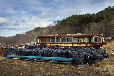 Sacks of contaminated topsoil and other radioactive waste taken from contaminated areas as part of the clean up process following the 2011 Fukushima Daiichi nuclear disaster. The bags will be removed...