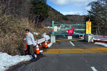 A Greenpeace activist measuring radioactivity at one of the checkpoints that give access to the restricted area near the Fukushima nuclear reactor.  On 11 March 2011 a magnitude 9 earthquake struck 13...