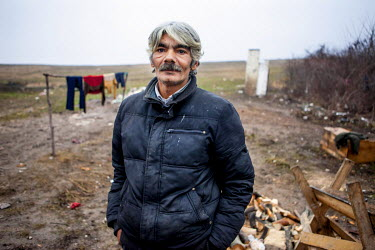 Rudolf (52) in the grounds of his house which, after one year of contruction, his extended family are able to live in. The family are one of six who have joined a pilot project called 'From Shack into...