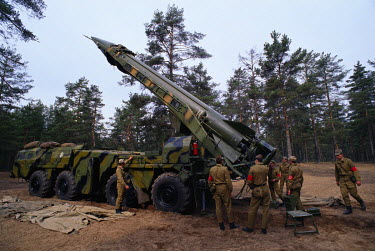 A tactical missile crew during an exercise with a camouflaged R-300 scud class mobile rocket. It has a 300km range nuclear warhead capable of reaching parts of Western Europe or for use in a battlefie...