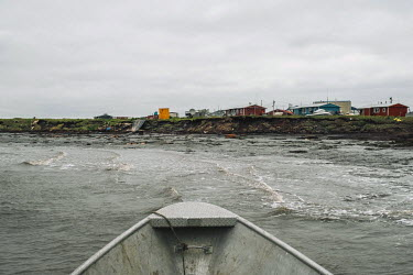 Houses standing on eroded banks of Ninglick River. Newtok is one of many places in Alaska that are under imminent threat from climate change. Permafrost thaw, regular floods and coastal erosion make i...