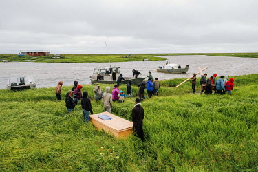 People carrying a coffin to Newtok cemetery that is located on the other bank of Kealavik River across from the village.  Newtok is one of many places in Alaska that are under imminent threat from cli...