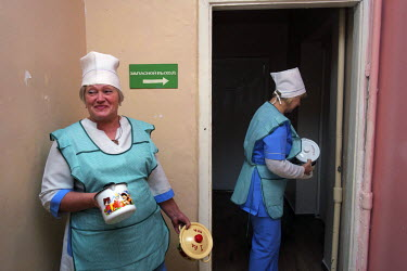 Care workers at the Antoshka orphanage come to pick up lunch for the children. There are 83 orphans from the age of two months to four years. Most of them are disabled and many of them need special ca...