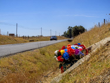 A roadside memorial for a traffic acident victim on the N2 national road near Almodovar.