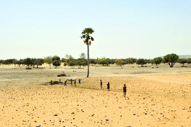 Children at a well used by migrating pastoralists and their livestock in the province of Guidimakha. Drought, due to climate change, has severely affected the Sahel and the way of life of the region's...