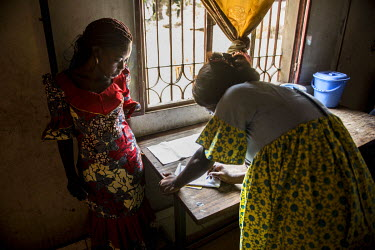 Rachel, a nurse attached to the PODI Ouest conducts a house visit to test eight children from the same family for HIV. The PODIs, which are run by the RNOAC (Reseau national des organisations d'assise...