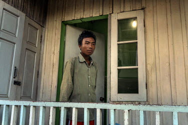 Win Tun, 28, stands outside his room in the Hope Centre HIV hospice. He is a freelance jade miner who has been injecting heroin, using shared needles, for many years and has only recently discovered h...