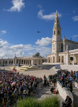 Pope Francis, welcomed by a cheering and joyful crowd, arrives by helicopter at the sanctuary of Fatima.  On 12 and 13 of May 2017 the shrine of Fatima celebrated the centenary of the appearence of (s...