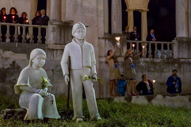 Pilgrims hold candles next to statues of the two shepherd children, Francisco and Jacinta, who witnessed the apparitions of Virgin Mary one hundred years earlier. On 12 and 13 of May 2017 the shrine o...