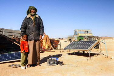 Mohamed Brahim, 57, and his son Farsia stand outside their house in Smara camp, one of five refugee camps where refugees from Western Sahara have been housed by the Algerian Government since 1975.