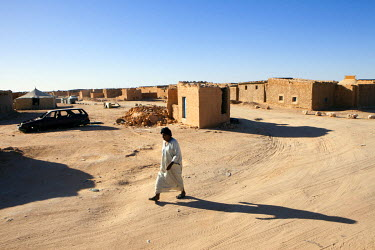A man walks through Smara refugee camp, one of five refugee camps where refugees from Western Sahara have been housed by the Algerian Government since 1975.