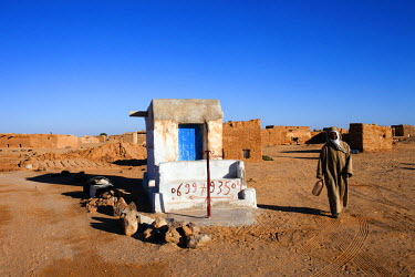 A man walks past a petrol supply post at Aousserd refugee camp, one of five refugee camps where refugees from Western Sahara have been housed by the Algerian Government since 1975.