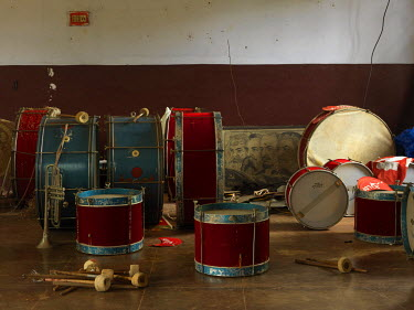 Drums and other instruments on the floor of a room in the Communist Party of India's Taliparamba South local committee office.