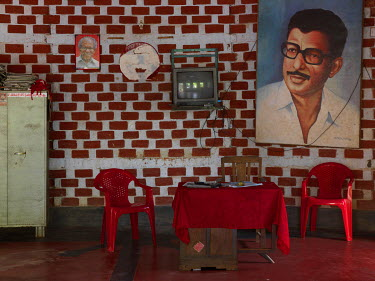 A portrait of N. Jayadevan, a Communist Party of India member of parliament representing Thrissur Lok Sabha constituency, hanging on a wall in the Cherpu local council office.