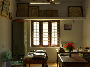 The Communist Party of India's (CPI) Muhamma local committee office. On the wall next to the window is a framed double portrait of the late leader of the CPI, Elamkulam Manakkal Sankaran Namboodiripad...