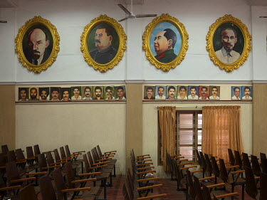 A meeting hall in the Communist Party of India's Kannur district committee office with portraits of local party activists in a row beneath portraits of Lenin, Stalin, Mao and Ho Chi Minh.
