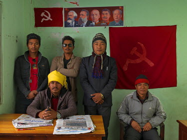 Members of the Communist Party of Nepal (Revolutionary Maoist), aka CPN-Maoist (Baidya) in the Pokhara district contact office. Standing: three members of the party's youth wing; a journalist on the p...