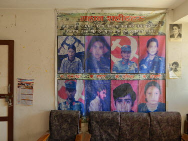 Portraits of local Maoist martyrs, killed in clashes with security forces during the Maoist uprising, printed on a banner in the Banepa district committee office of the United Communist Party of Nepal...